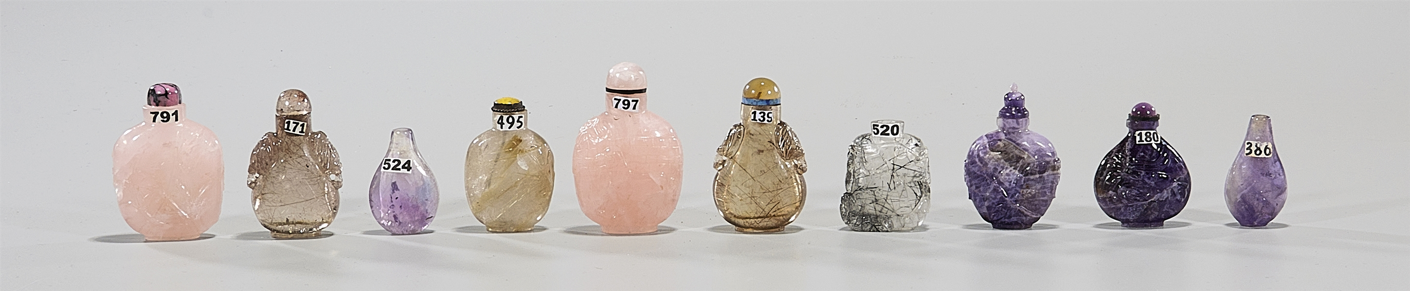 Group of Ten Crystal & Amethyst Snuff Bottles