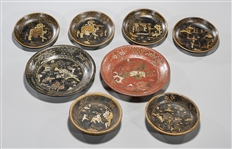 Group of Eight Chinese Decorated Lacquer Dishes